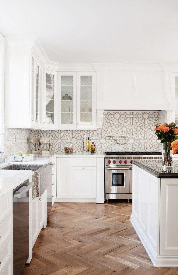 Herringbone floor and white tile backsplash
