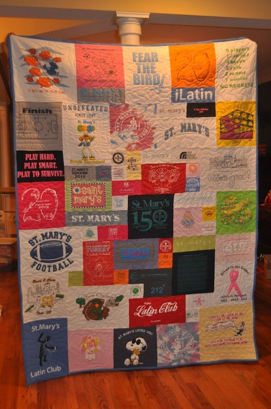 T shirt quilt – i like this version with different sized squares! Cute!