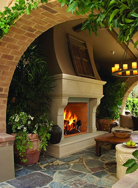outdoor covered patio with fireplace Arched entry into covered patio ~ love the fireplace