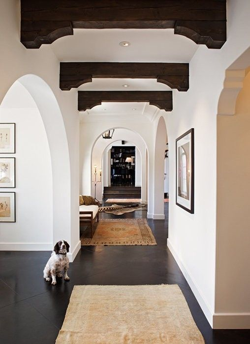 Mediterranean Hallway With Concrete Floors Exposed Beam