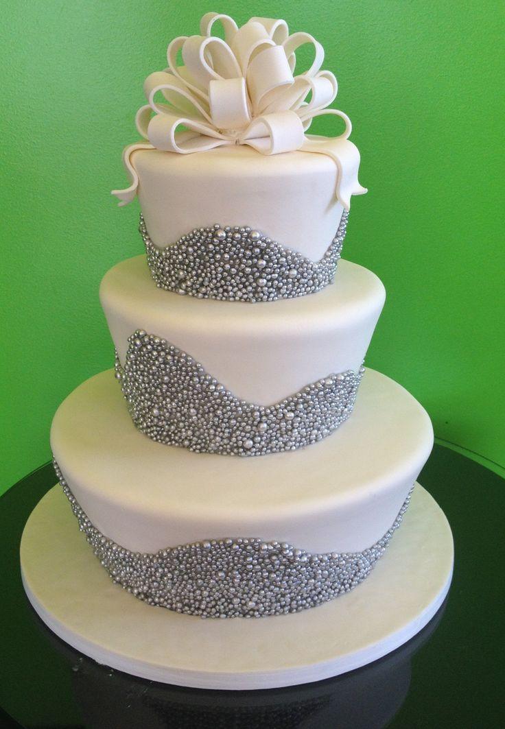 Fun Flared Three Tiered Wedding Cake With White Fondant