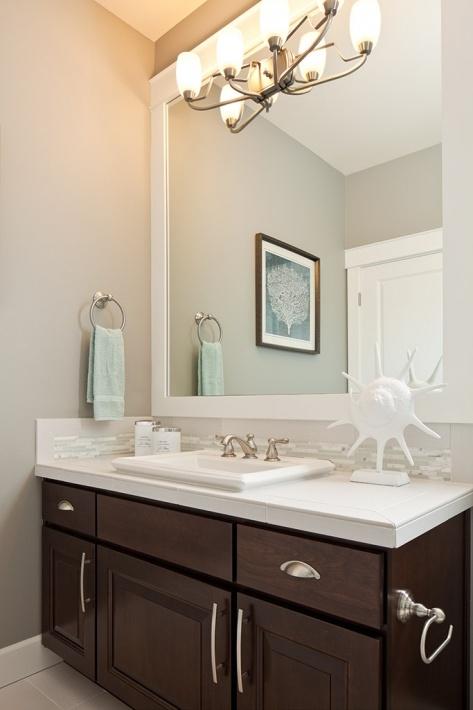 Kid S Bathroom Dark Cabinets White Countertops Gray