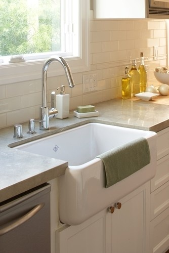 Limestone kitchen countertops in a kitchen. YES you CAN! Love them here with whi