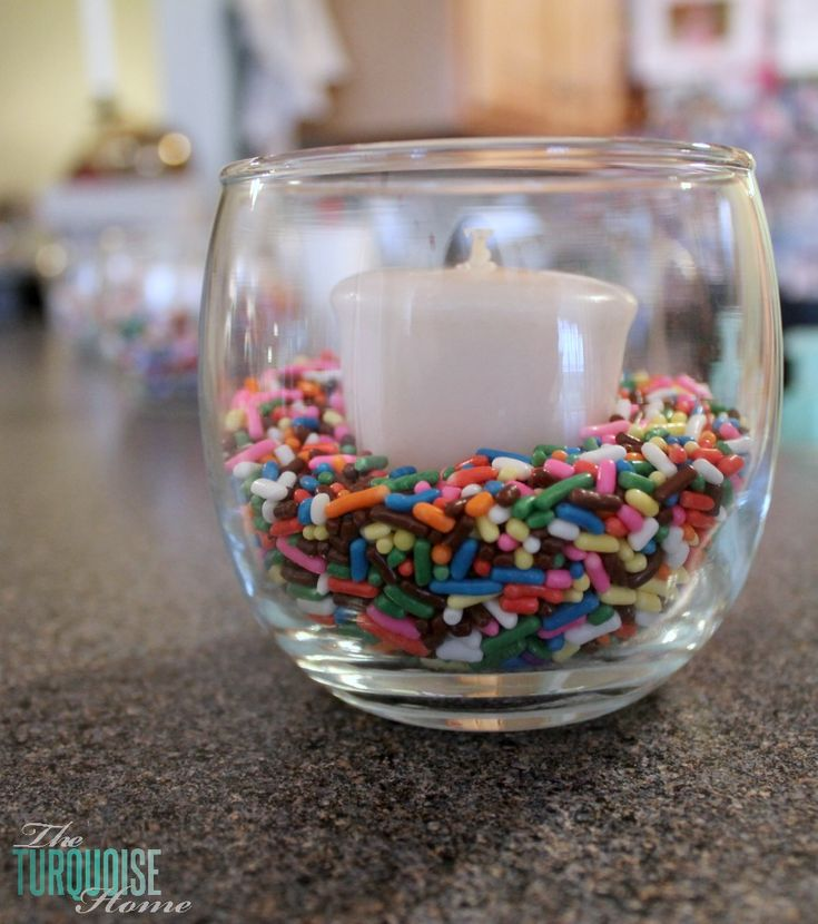 DIY  Party Decor :: Place a votive candle in a jar with some colorful sprinkles…..cheap and easy grad party table lights