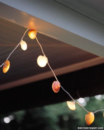 """What a cleaver way to add a """"theme"""" to outdoor decor.  Just take small shells and glue them to a string of white lights.  Results:"""