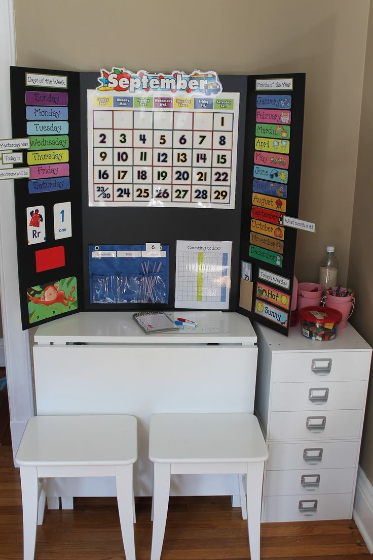 Great link to a cute DIY preschool board. I love how it can close up and doesnt make your home look like a classroom all the time :) great for
