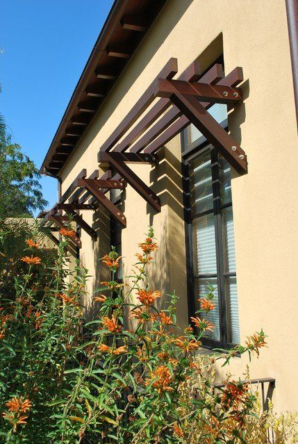 Rustic Exterior Awnings Casement Windows Stucco Wall
