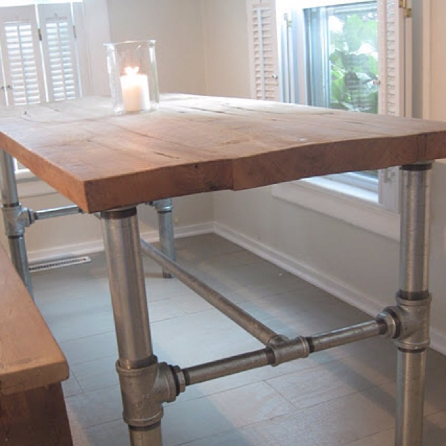 Reclaimed Wood Table With Galvanized Steel Framework Below