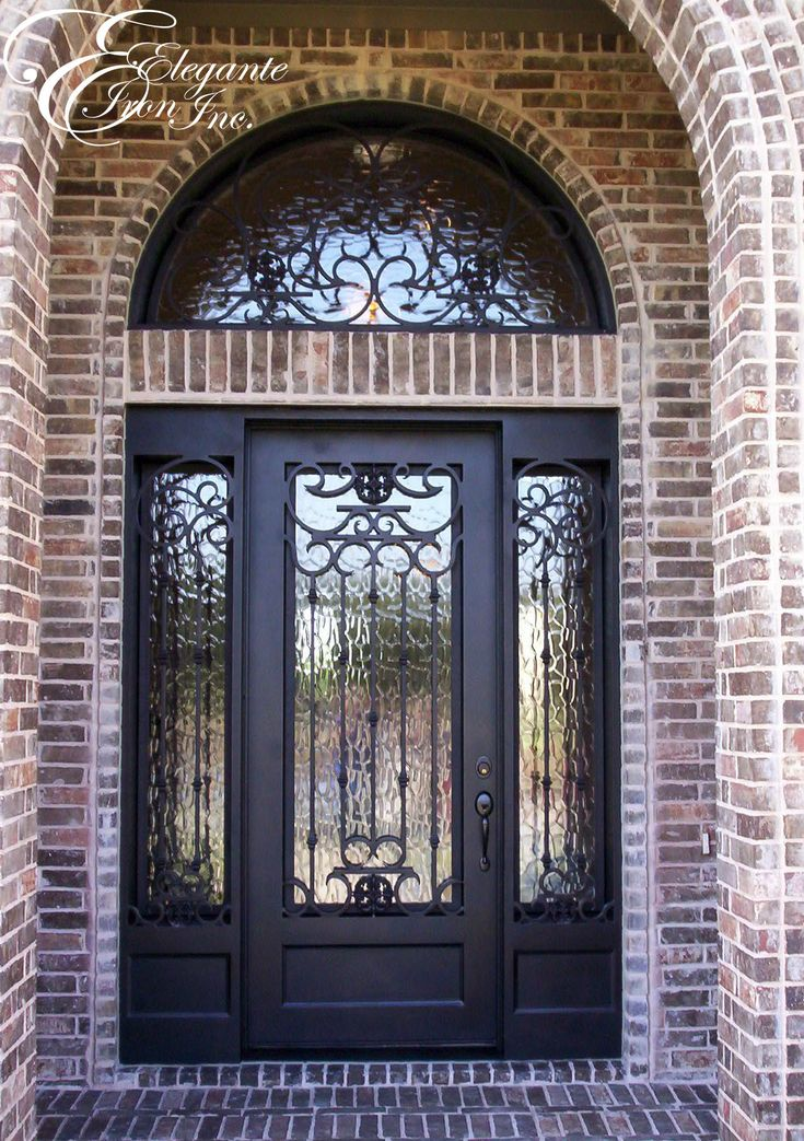 Custom Wrought Iron Door With Sidelights And A Full Arch