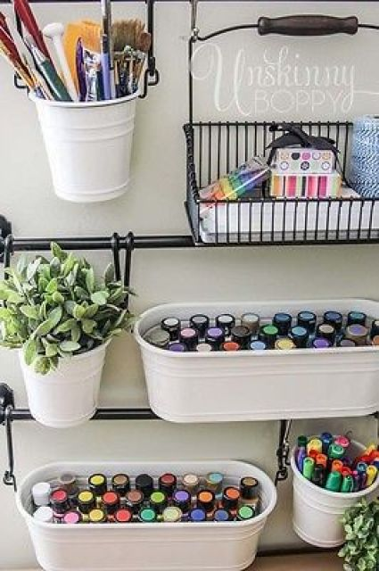 Pretty genius idea for craft room (or essential oil) storage organization-- hang buckets on the wall!: