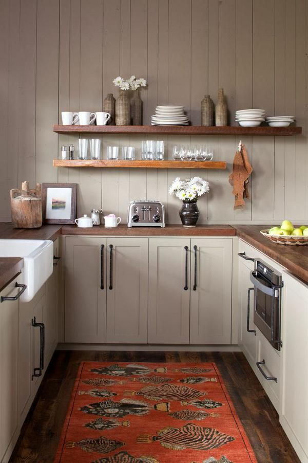 cozy u shaped kitchen with open shelving by altlanta based carter kay interiors via desire to on u kitchen ideas small id=49447