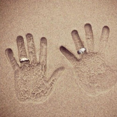 wedding rings (sand,rings)  I would add the wedding date to make this a save the