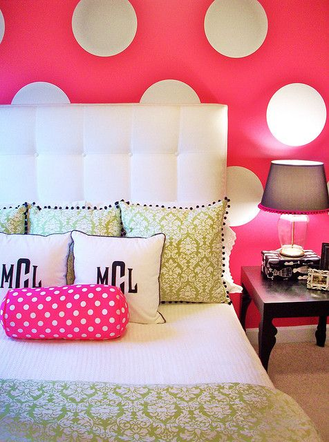 fun girls bedroom with a bold hot pink and white polka dot wall.