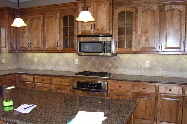 What Color Cabinets Go With Baltic Brown Granite ~ Anyone ... on What Color Countertops Go With Maple Cabinets  id=58341