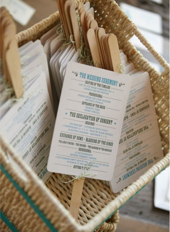 the wedding ceremony programs on fans…like this for our outdoor wedding!