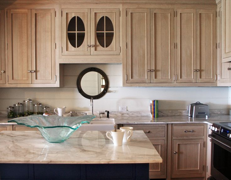 The artisan collection is unmatched as a result of our attention to detail and high regard for materials, design, quality and value. Kitchen - by Mrs. Phoebe Howard; horizontal shiplap wall, warm color marble countertop, bleached