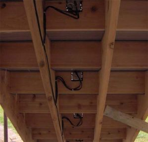 Underside of deck steps showing low voltage deck lighting junction boxes and wiring | Ideas for