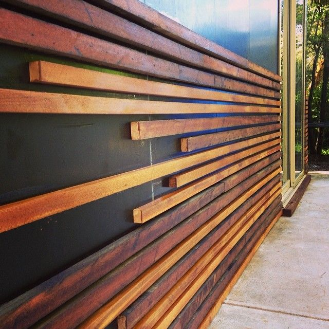 External Cladding Made From 1970s Cedar Wall Panels And