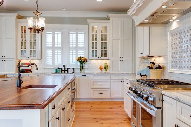 i m loving this white kitchen double stacked floor to ceiling cabinets around sink area on kitchen cabinets around window id=16190