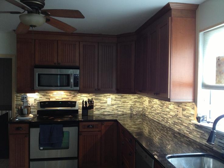 Kraftmaid maple cinnamon cabinets with black galaxy ... on Backsplash For Maple Cabinets And Black Granite  id=96689