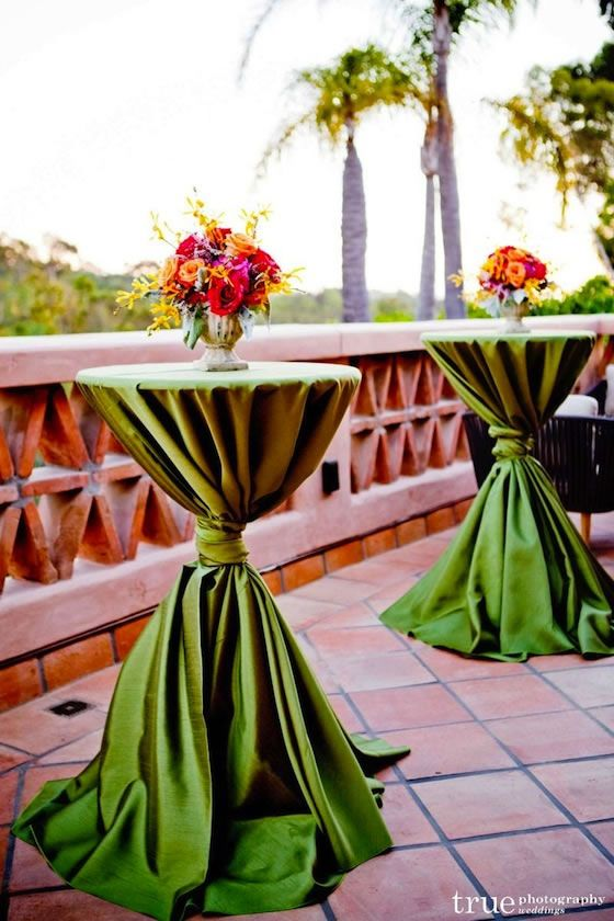 Lime green cocktail table linens pop against the tiled terrace.: