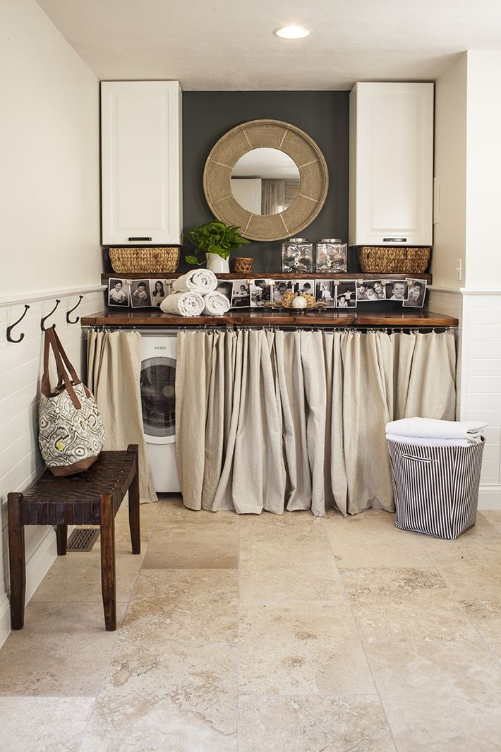 Super cute laundry nook. I love the wood countertop over the washer/dryer…the
