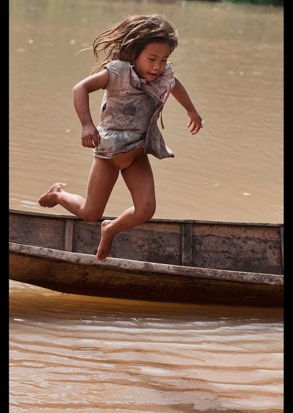 Lanten girl jumping into the Nam Ha River, Luang Nam Tha ...