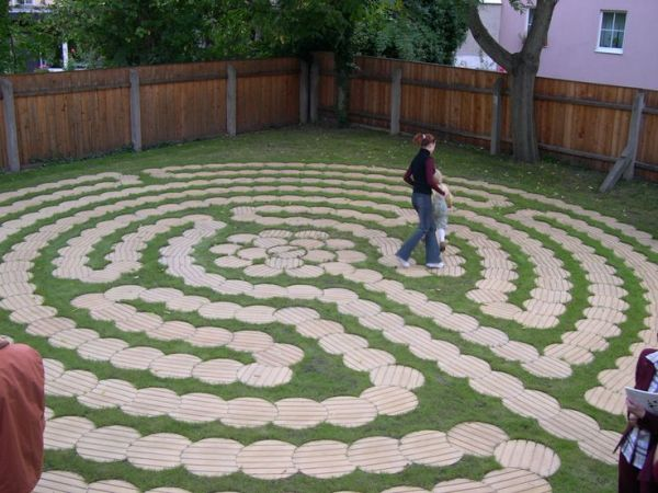 labyrinth flower garden designs Labyrinth made of round wooden boards cut just right. Nice