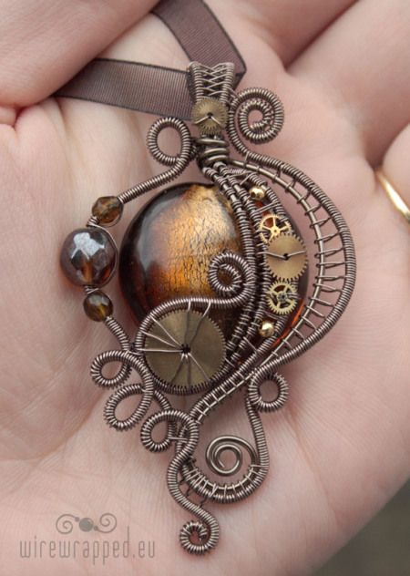 Victorian styled Steampunk pendant with polished glass, wire wrapping and watch