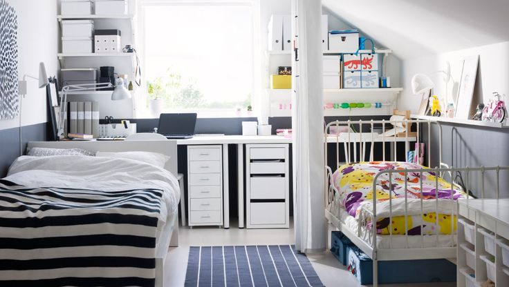 A Parent And Child Shared Bedroom And Workspaces With