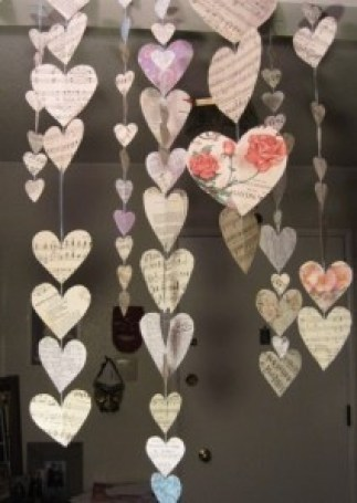 Heart garland that hangs up and down. Easy to make and beautiful. Could see it in a window, hanging from a chandelier over a table or in a doorway. Lovely.