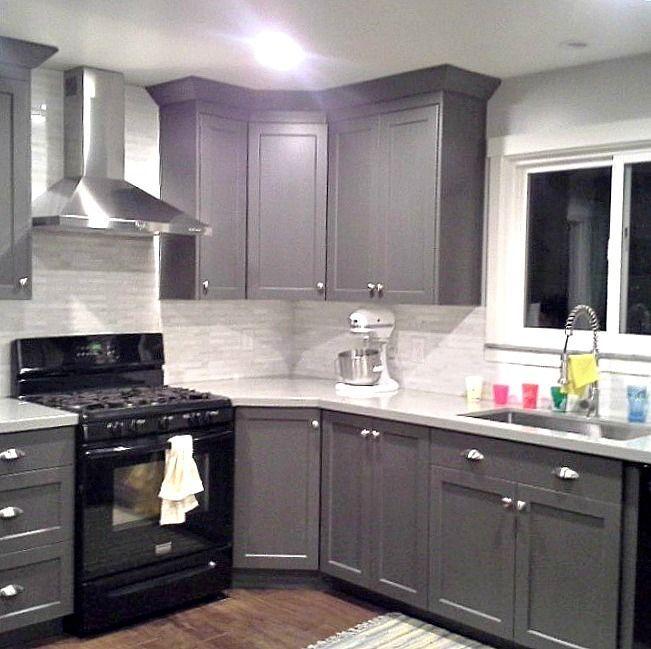 grey cabinets black appliances silver hardware full tile backsplash really good example on kitchen ideas gray id=48447