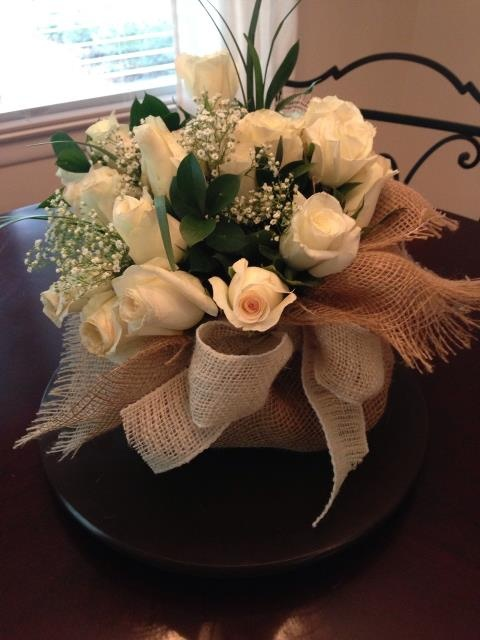 Flower Arrangement Wrapped In Inexpensive Ground Cover
