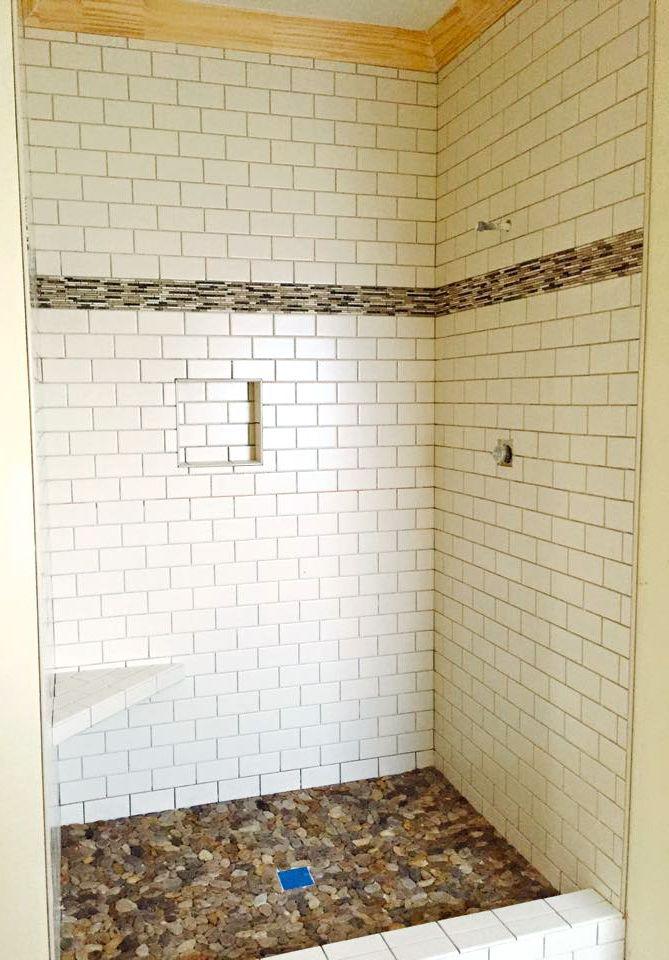 White Subway Tile With River Rock Bottom Shower Designed