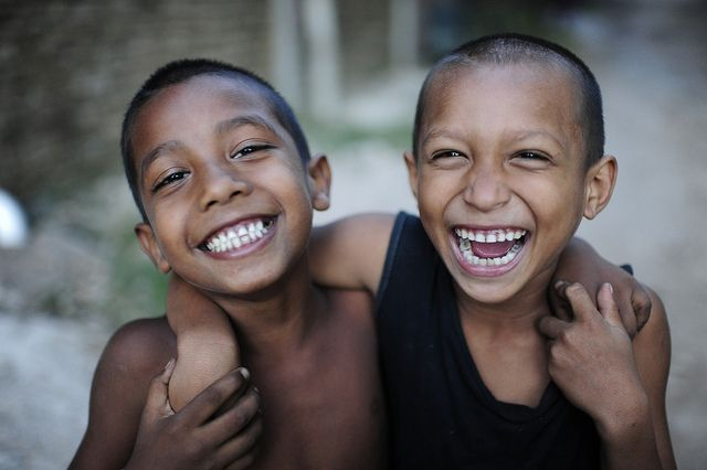 Two smiling kids. They are very happy.