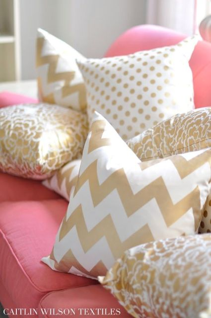 gold pillows on hot pink.
