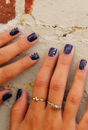 Navy blue nails with white dots. Simple & classy. Can try with other colors.