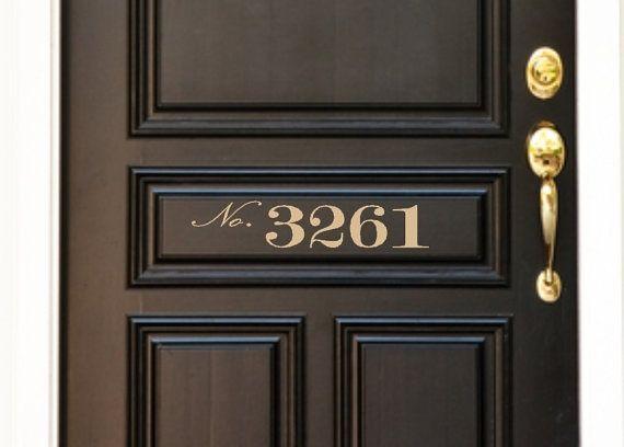 Love the black door with gold numbers.: