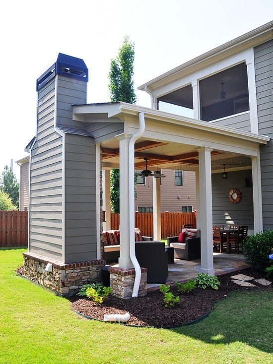 Outdoor covered patio with fireplace, great addition idea.