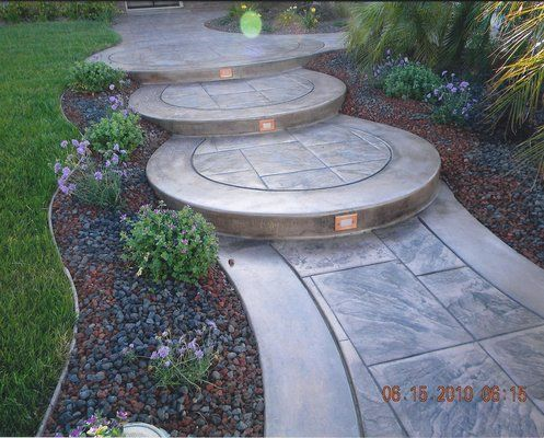 curved concrete steps with recessed lighting and stamped on awesome deck patio outdoor lighting ideas that lighten up your space id=92475