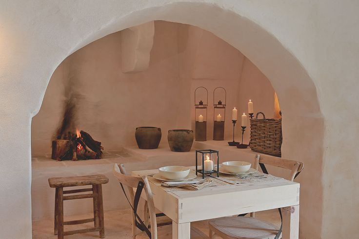 Private dining space at Masseria Le Carrube in Puglia, Italy with white stucco walls and candle light