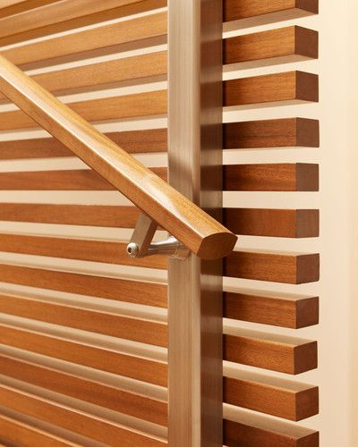 Handrail detail on wood slat staircase wall
