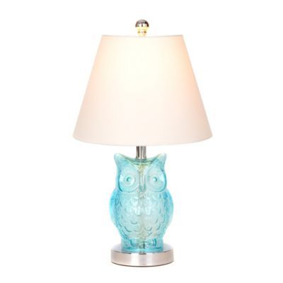 Blue Glass Owl Table Lamp | Kirkland's; $19.99 You'll love how the adorable, ice blue owl figure on the base and the silver metal details glow when the light is on! Lamp measures 18.5H in. Crafted of glass and metal. Blue glass owl on the base. Silver metal details. Hardback empire shade in white linen. Shade measures 8H x 10.5 in. diameter (at widest). Socket accommodates a 40-watt, type A bulb Features a white, plug-in cord. *White ceramic owl lamp also avail.