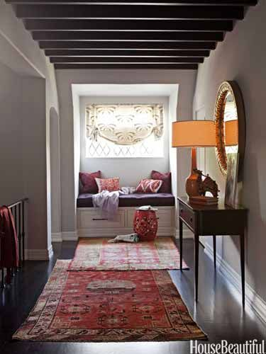 layering rugs in the hallway: