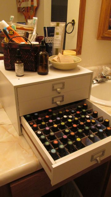 Essential oil storage solution. Upper drawers hold homemade creams, roll-ons, and books.: