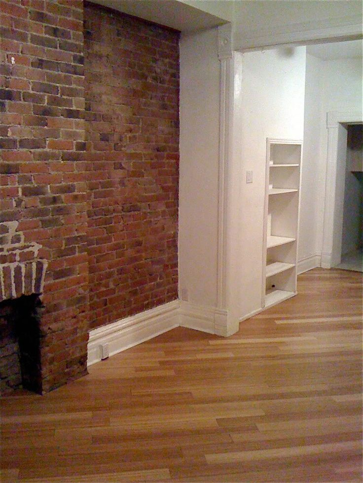 Living Room Exposed Brick Bamboo Hardwood Floors Photo