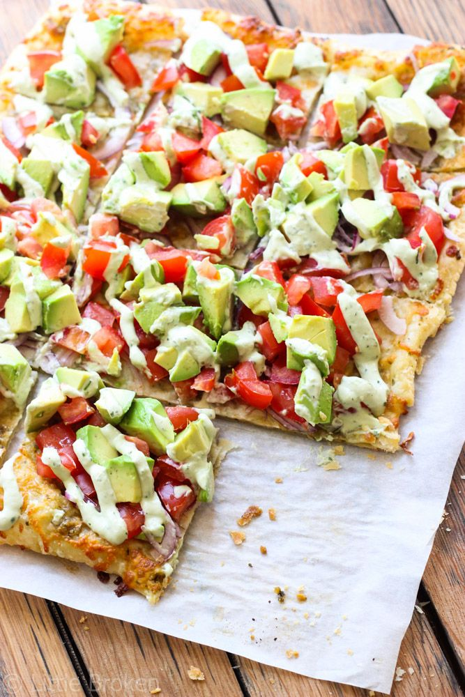 Skinny Avocado Pizza – Topped with avocados, tomatoes, red onion, cheeses, zesty