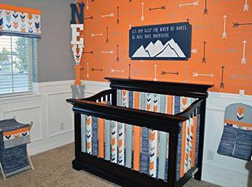 A Grey Orange And Navy Blue Fox Themed Baby Nursery With