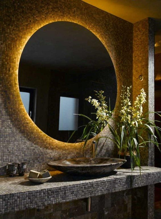 Ultra dark bathroom interior with LED retrofitted oval mirror. Ultra warm white LED Strip (2300-2500K)