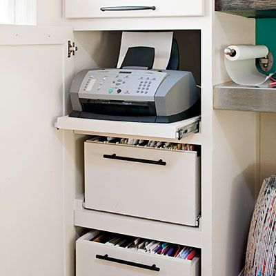 Hidden storage in an existing cabinet by modifying the shelves with sliders for easy access to files and printer. Smart.